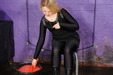 view details of set gm-2g011, Felicity in black catsuit, heeled boots, and studded dress, makes a right mess of herself!